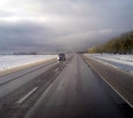 ФОТОФАКТ: В районе Искитима вдоль трассы М-52 замечен снежный покров