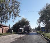 Срезают асфальт на «убитой дороге» в Бердске